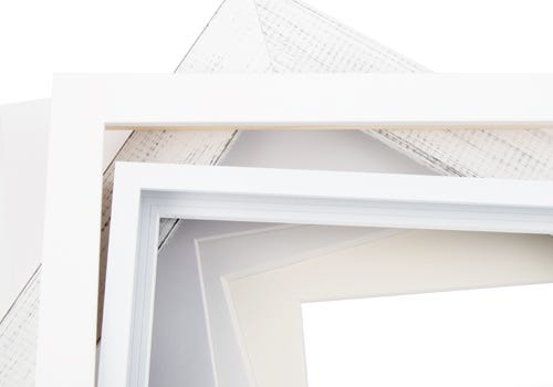 White frames and mat boards
